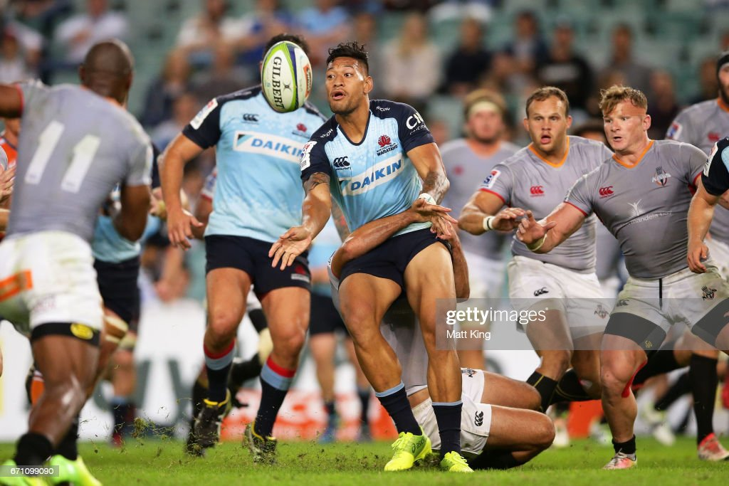 Israel Folau of the Waratahs offloads the ball in a tackle during the round nine Super Rugby match between the Waratahs and the Kings at Allianz Stadium on April 21, 2017 in Sydney, Australia.