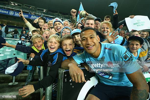 Israel Folau of the Waratahs poses with fans after winning the round 18 Super Rugby match between the Waratahs and the Reds at Allianz Stadium on...