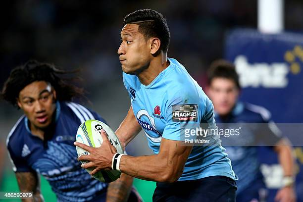 Israel Folau of the Waratahs runs the ball during the round 11 Super Rugby match between the Blues and the Waratahs at Eden Park on April 25 2014 in...