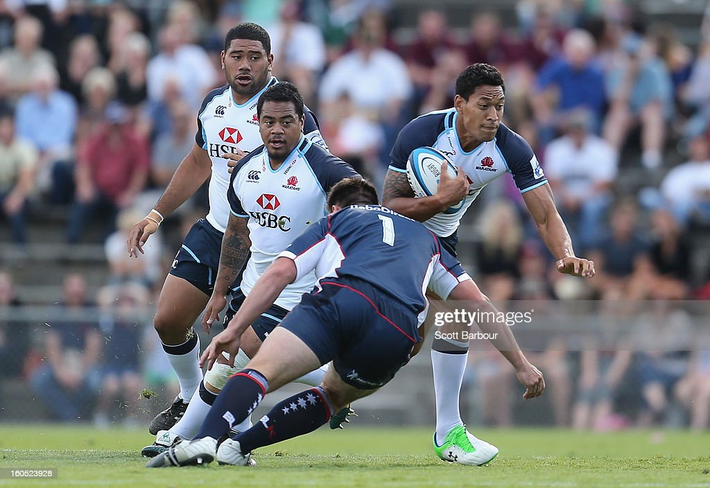 Israel Folau of the Waratahs runs with the ball during the Super Rugby trial match between the Waratahs and the Rebels at North Hobart Stadium on February 2, 2013 in Hobart, Australia.