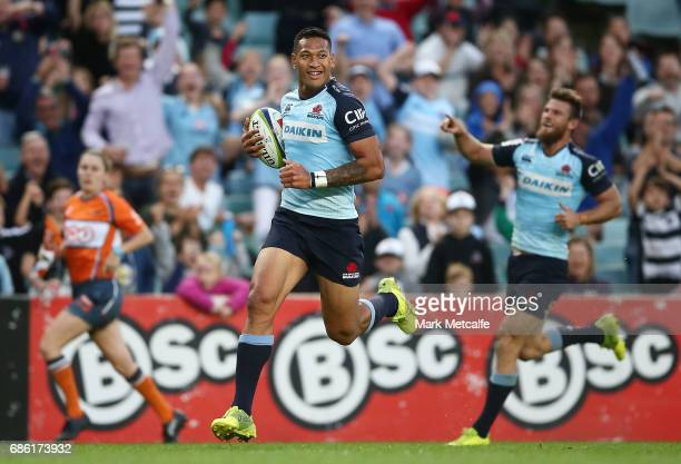 Israel Folau of the Waratahs scores a try during the round 13 Super Rugby match between the Waratahs and the Rebels at Allianz Stadium on May 21 2017...
