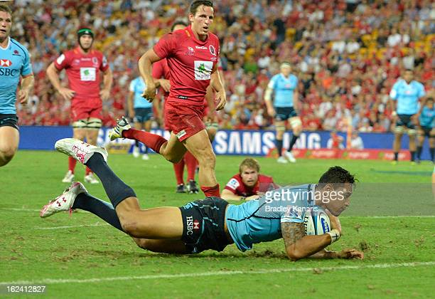 Israel Folau of the Waratahs scores a try during the round two Super Rugby match between the Reds and the Waratahs at Suncorp Stadium on February 23...