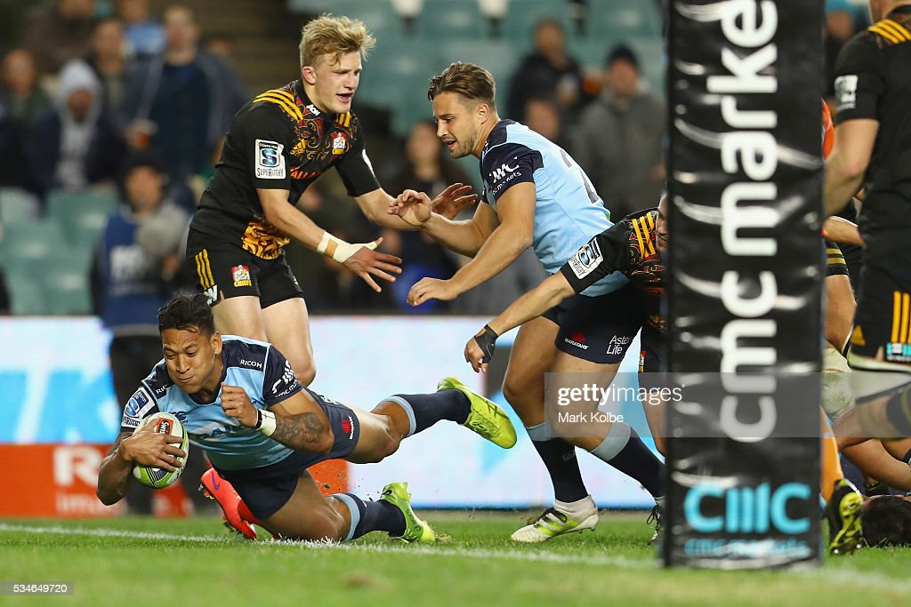 <a gi-track='captionPersonalityLinkClicked' href=/galleries/search?phrase=Israel+Folau&family=editorial&specificpeople=4194699 ng-click='$event.stopPropagation()'>Israel Folau</a> of the Waratahs scores try during the round 14 Super Rugby match between the Waratahs and the Chiefs at Allianz Stadium on May 27, 2016 in Sydney, Australia.