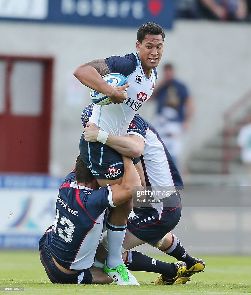 Israel Folau of the Waratahs stands in a tackle during the Super Rugby trial match between the Waratahs and the Rebels at North Hobart Stadium on February 2, 2013 in Hobart, Australia.
