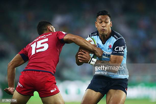 Israel Folau of the Waratahs takes on the defence during the round one Super Rugby match between the Waratahs and the Reds at Allianz Stadium on...