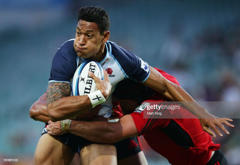 <a gi-track='captionPersonalityLinkClicked' href=/galleries/search?phrase=Israel+Folau&family=editorial&specificpeople=4194699 ng-click='$event.stopPropagation()'>Israel Folau</a> of the Waratahs takes on the defence during the Super Rugby trial match between the Waratahs and the Crusaders at Allianz Stadium on February 14, 2013 in Sydney, Australia.