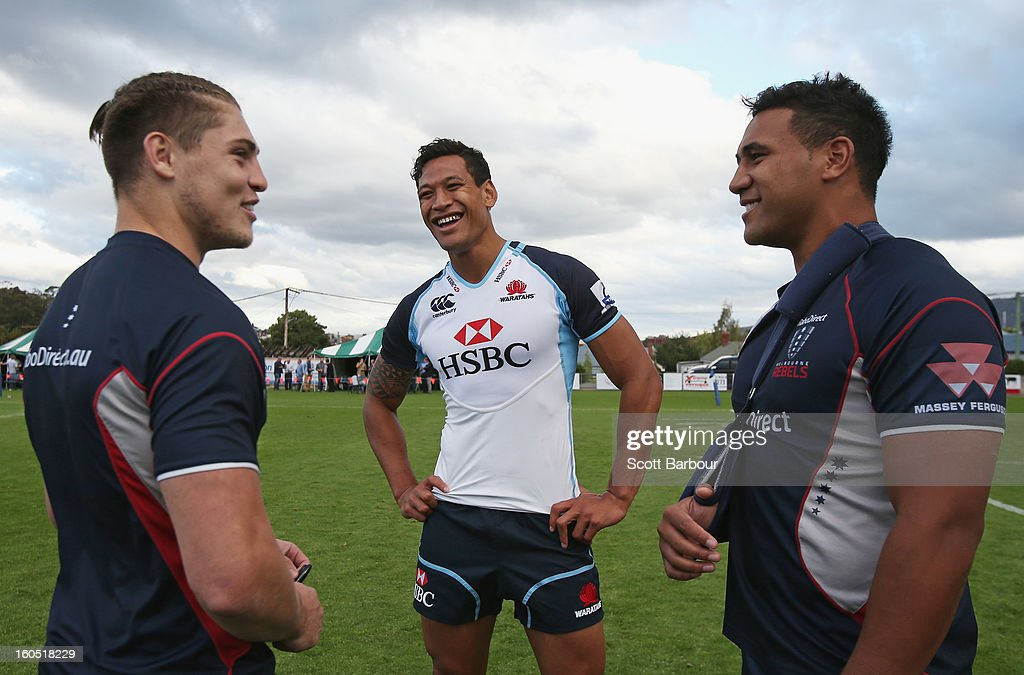 Israel Folau (C) of the Waratahs talks with James O'Connor and Cooper Vuna of the Rebels after the Super Rugby trial match between the Waratahs and the Rebels at North Hobart Stadium on February 2, 2013 in Hobart, Australia.
