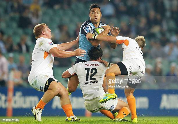 Israel Folau of the Waratahsis tackled during the round 11 Super Rugby match between the Waratahs and the Cheetahs at Allianz Stadium on May 7 2016...