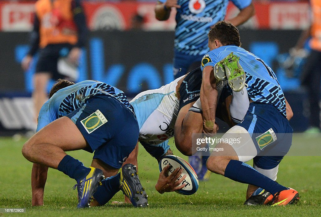 Israel Folau of Waratahs gets tackled by Bjorn Basson of the Bulls during the Super Rugby match between Vodacom Bulls and Waratahs at Loftus Versveld on April 27, 2013 in Pretoria, South Africa.
