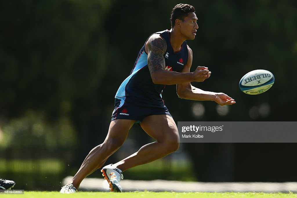<a gi-track='captionPersonalityLinkClicked' href=/galleries/search?phrase=Israel+Folau&family=editorial&specificpeople=4194699 ng-click='$event.stopPropagation()'>Israel Folau</a> passes during a Waratahs Super Rugby training session at Victoria Barracks on February 18, 2013 in Sydney, Australia.