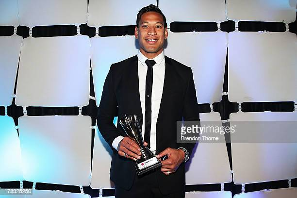 Israel Folau poses with the trophy for Best Back during the HSBC Waratahs Awards Dinner at The Ivy on August 29 2013 in Sydney Australia