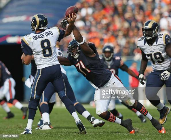 Israel Idonije of the Chicago Bears knocks the ball away from Sam Bradford of the St Louis Rams at Soldier Field on September 23 2012 in Chicago...