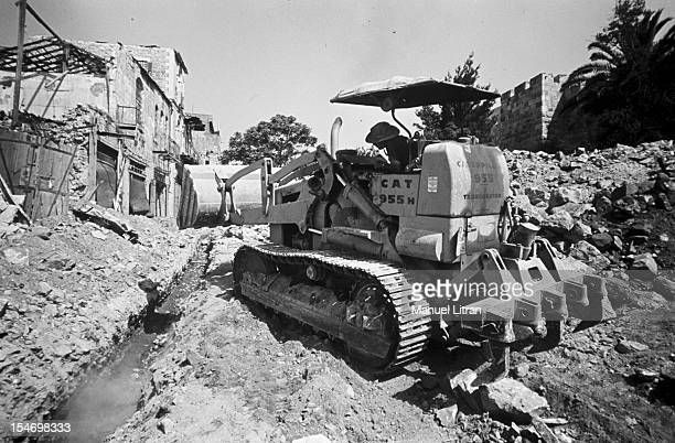 Israel in July 1967 A bulldozer clears the ruins of a house