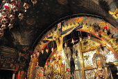 Jerusalem, Israel: Holy Sepulcher church - Calvary (Golgotha), traditionally regarded as the site of Jesus' crucifixion - main altar, run by the Greek Orthodox, which contains The Rock of Calvary, 12t