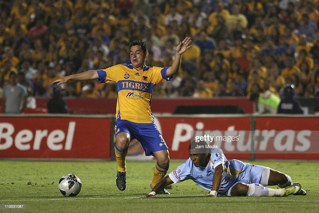 Israel Jimenez (L) of Tigres struggles for the ball with Wilmer Aguirre (R) of San Luis during the Clausura 2011 Tournament in the Mexican Football League at Universitary Stadium on March 12, 2011 in Monterrey, Mexico.