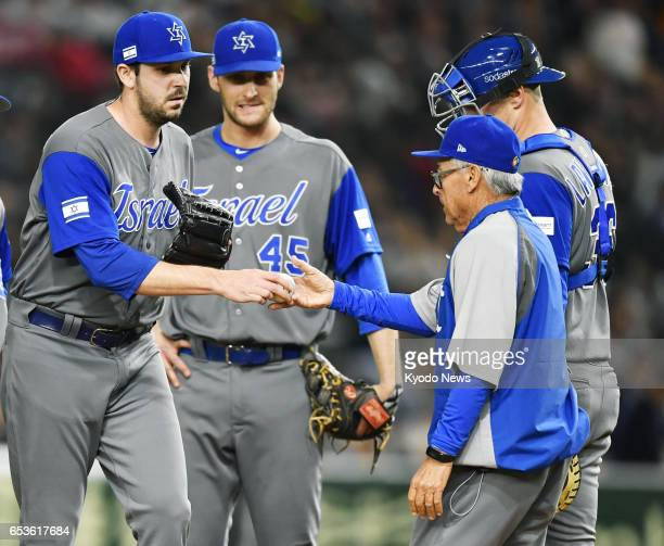 Israel manager Jerry Weinstein makes a pitching change in the sixth inning of a World Baseball Classic secondround game against Japan at Tokyo Dome...