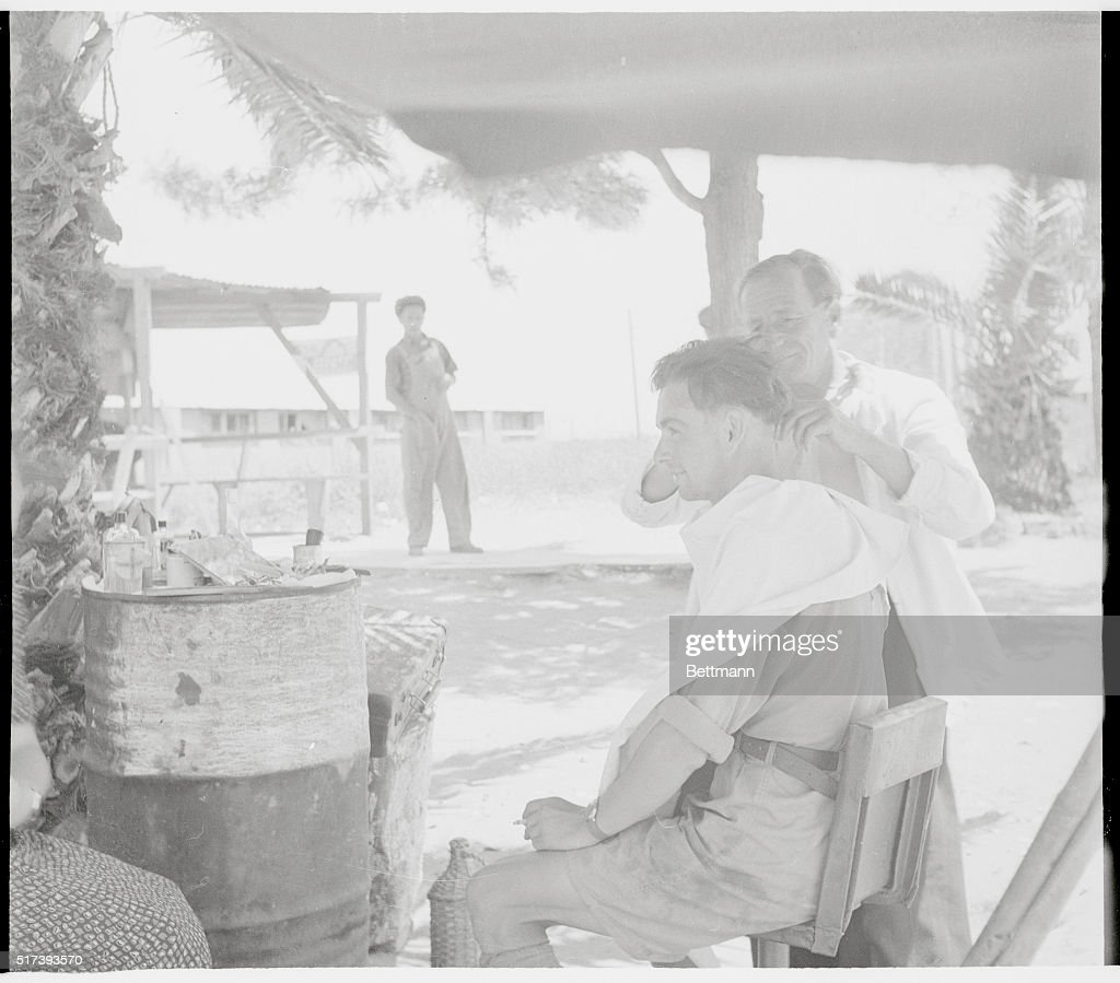 man getting haircut at encampment pictures getty images many of the immigrants at the pardess channa camp possess skills which they are eager