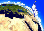 3D render of the national flag of Israel over the geographic location of the country on a world map. Parts of this image furnished by NASA.