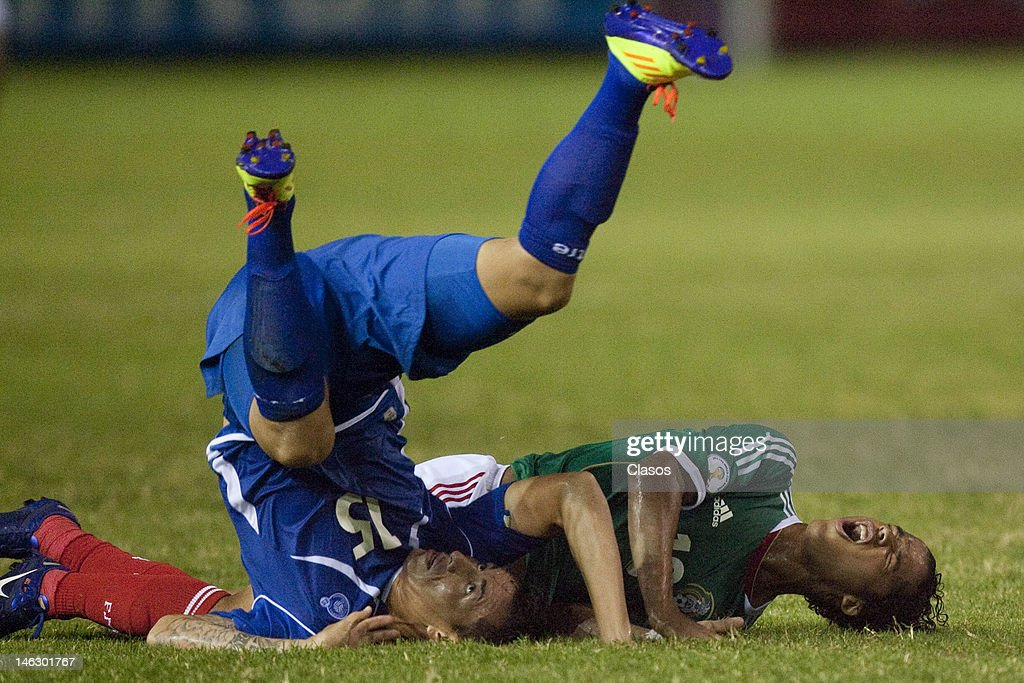 Israel Pacheco of El Salvador and Giovani Dos Santos of Mexico fight for a ball during a match between El Salvador and Mexico at Cuscatlan Staduim, as part of CONCACAF qualifiers for the World Cup Brazil 2014, on June 12, 2012 in San Salvador, El Salvador.