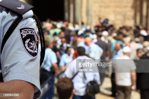 Israel Police Officer in the Crowded Street