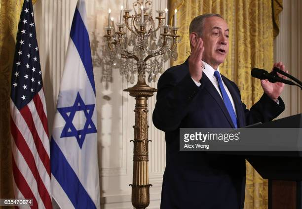Israel Prime Minister Benjamin Netanyahu and US President Donald Trump participate in a joint news conference at the East Room of the White House...
