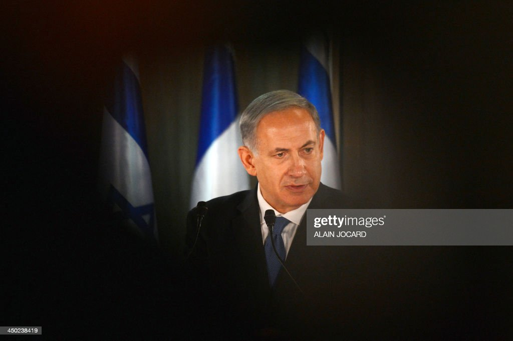 Israel Prime Minister Benjamin Netanyahu speaks during a joint press confrence with French President (unseen) at his residence in Jerusalem on November 17, 2013. France will never tolerate nuclear proliferation, President Francois Hollande vowed today as he arrived in Israel for a visit dominated by the dispute over Iran's nuclear programme. AFP PHOTO/POOL/ALAIN JOCARD