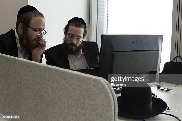 Israel Rosenberg tech entrepreneur and cofounder of Pareto right and David Weinberg tech enterpreneur and cofounder of Pareto work at a computer...