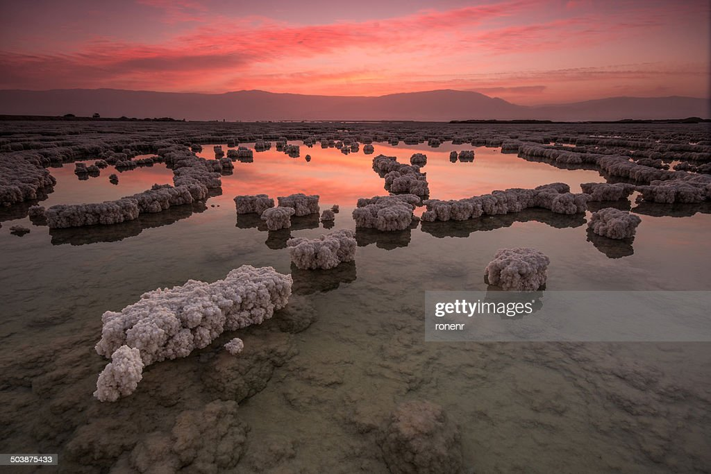 Israel, Sunrise over crystals in Dead Sea