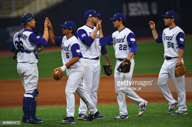 Israel team players celebrate their victory against the Netherlands after their first round game of the World Baseball Classic at Gocheok Sky Dome in...
