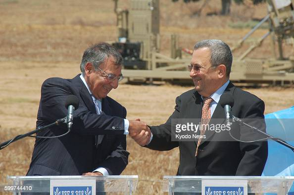 ASHKELON Israel US Defense Secretary Leon Panetta and Israeli Defense Minister Ehud Barak shake hands after their joint press conference in Ashkelon...