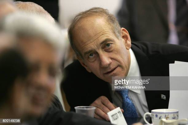 Israeli acting Prime Minister Ehud Olmert looks over during a Foreign affairs and Defense committee session at the Knesset in Jerusalem 22 February...