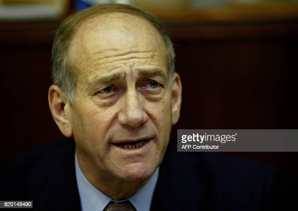 Israeli acting Prime Minister Ehud Olmert speaks at the weekly cabinet meeting in Jerusalem 05 March 2006 Olmert called on religious leaders Sunday...