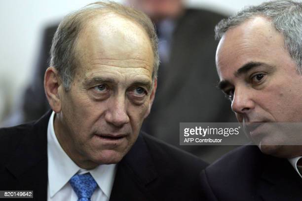 Israeli acting Prime Minister Ehud Olmert talks with committee's chairman Yuval Steinitz during theForeign affairs and Defense committee session at...