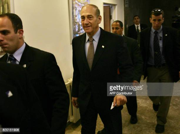 Israeli acting Prime Minister Ehud Olmert walks into the weekly cabinet meeting in Jerusalem 05 March 2006 Olmert called on religious leaders Sunday...