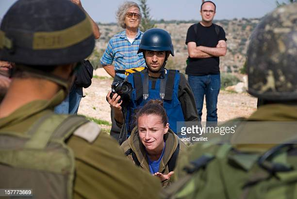 Israeli activist and soldiers in Bil'in, West Bank