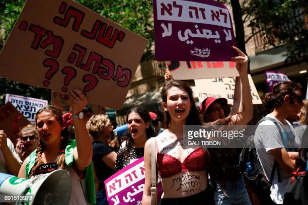 Israeli activists chant slogans as they carry placards during the 6th annual SlutWalk march through central Jerusalem on June 2 to protest rape...