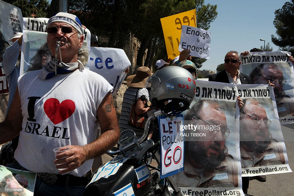 Israeli activists hold up pictures of Jonathan Pollard, a Jewish American who was jailed for life in 1987 on charges of spying on the United States, during a protest calling for his release outside Israeli President Shimon Peres's residence during his meeting with a delegation of 35 US Republican members of congressmen on August 17, 2011 in Jerusalem. Pollard is a convicted Israeli spy and a former United States Naval civilian intelligence analyst who received a life sentence in the mid 1980s.