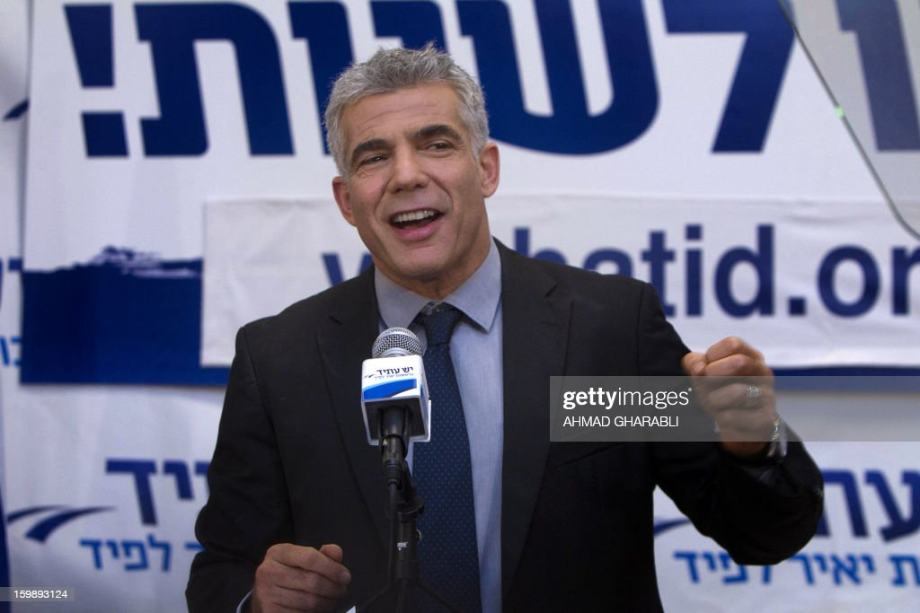 Israeli actor, journalist and author Yair Lapid, leader of the Yesh Atid (There is a Future) party, speaks to supporters early on January 23, 2013 at his party headquarters in Tel Aviv. Israeli Prime Minister Benjamin Netanyahu said it was necessary to form the 'broadest possible government' after his Likud-Beitenu list won a narrow election victory, with the centrist Yesh Atid in second place.