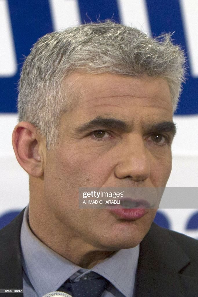 Israeli actor, journalist and author Yair Lapid, leader of the Yesh Atid (There is a Future) party, speaks to supporters early on January 23, 2013 at his party headquarters in Tel Aviv. Israeli Prime Minister Benjamin Netanyahu said it was necessary to form the 'broadest possible government' after his Likud-Beitenu list won a narrow election victory, with the centrist Yesh Atid in second place. AFP PHOTO/AHMAD GHARABLI