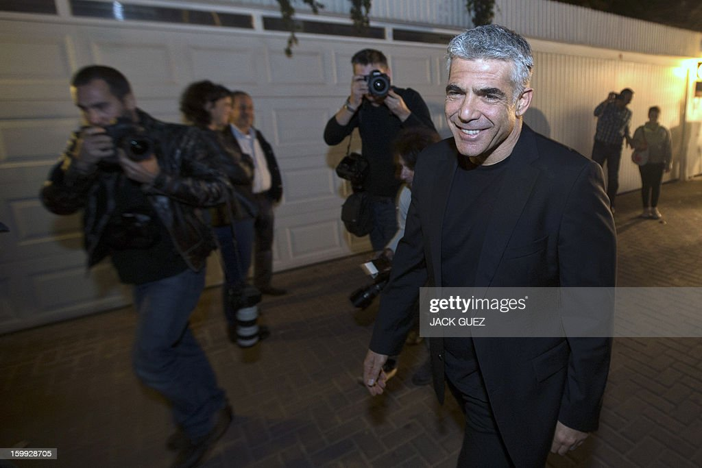 Israeli actor, journalist and author Yair Lapid, leader of the Yesh Atid (There is a Future) party, poses for pictures outside his home in Ramat Aviv, northern Tel Avivon on January 23, 2013. Lapid, Israel's newest political star, has the disillusioned middle class to thank for his shock electoral success, as the sector has felt increasingly marginalised, economically and ideologically.
