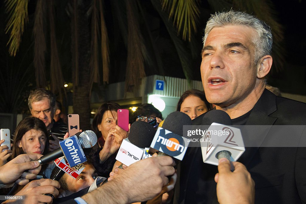Israeli actor, journalist and author Yair Lapid, leader of the Yesh Atid (There is a Future) party, speaks to journalists on January 23, 2013 outside his home in Ramat Aviv, northern Tel Aviv. Lapid, Israel's newest political star, has the disillusioned middle class to thank for his shock electoral success, as the sector has felt increasingly marginalised, economically and ideologically.