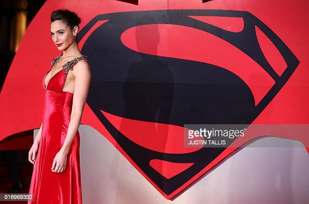 Israeli actress Gal Gadot poses for a photograph after arriving to attend the European Premiere of the film 'Batman v Superman Dawn of Justice' in...
