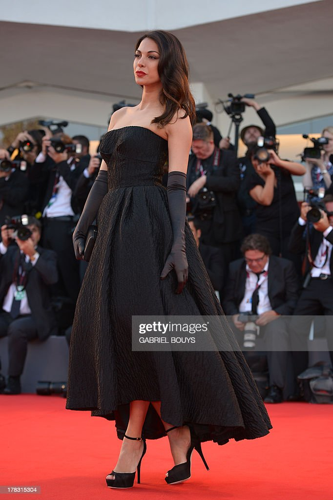 Israeli actress Moran Atias arrives for the opening ceremony of the 70th Venice Film Festival and the screening of the movie 'Gravity' presented out of competition, on August 28, 2013 at Venice Lido. The Venice film festival kicks off today with the arrival of movie stars on water taxis for a dark line-up flush with fiendish tales of abuse, betrayal and survival. The world's oldest film festival opens with 'Gravity', a 3-D sci-fi thriller starring George Clooney and Sandra Bullock as astronauts who are flung into deep space when a debris shower destroys their shuttle. AFP PHOTO / GABRIEL BOUYS