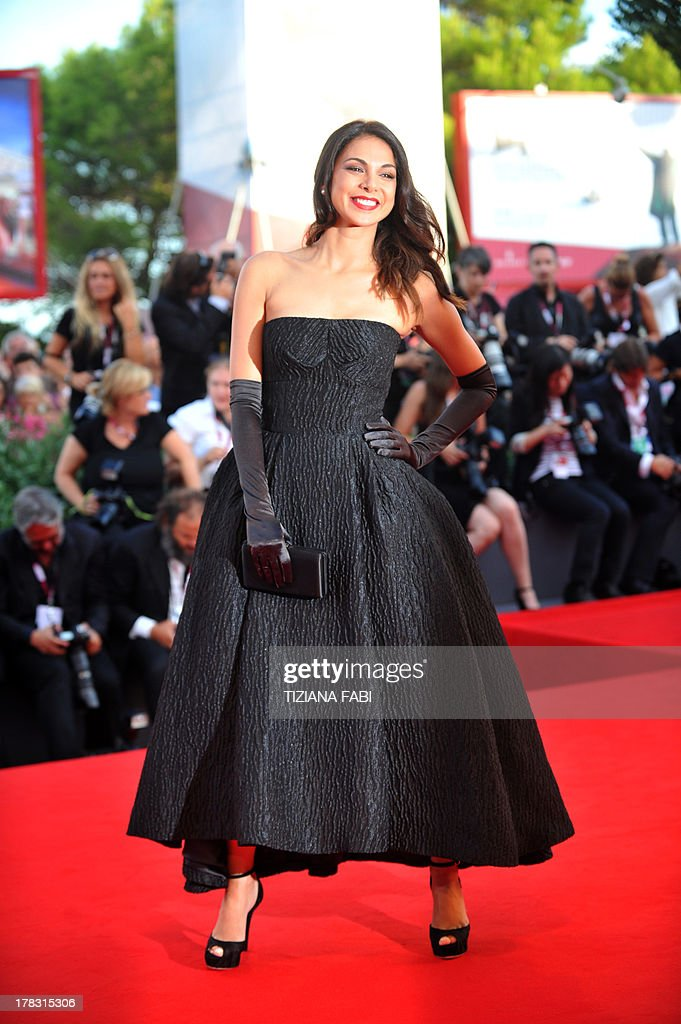Israeli actress Moran Atias arrives for the opening ceremony of the 70th Venice Film Festival and the screening of the movie 'Gravity' presented out of competition, on August 28, 2013 at Venice Lido. The Venice film festival kicks off today with the arrival of movie stars on water taxis for a dark line-up flush with fiendish tales of abuse, betrayal and survival. The world's oldest film festival opens with 'Gravity', a 3-D sci-fi thriller starring George Clooney and Sandra Bullock as astronauts who are flung into deep space when a debris shower destroys their shuttle. AFP PHOTO / TIZIANA FABI
