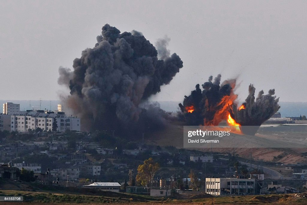 Israeli Air Force bombs explode on Palestinian targets in the northern Gaza Strip January 1, 2009 as seen from Israel's border with the Hamas-run territory. Israel continues to reinforce its troops amid talks of an internationally-brokered ceasefire.
