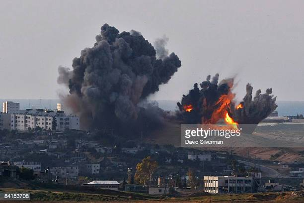 Israeli Air Force bombs explode on Palestinian targets in the northern Gaza Strip January 1 2009 as seen from Israel's border with the Hamasrun...