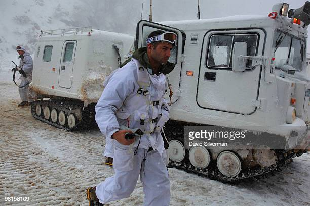 Israeli alpine troops disembark from a snowmobile at a military base on the snowcovered slopes January 25 2010 of Mount Hermon in the Golan Heights...