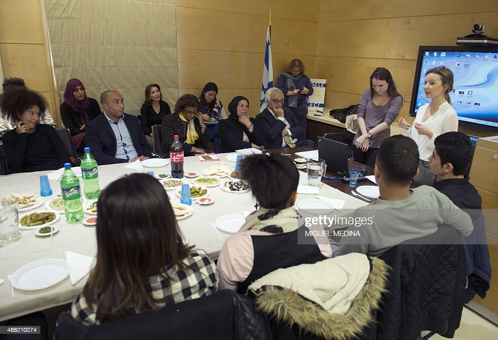 Israeli ambassador to France Yossi Gal (background 8thL) and Latifa Ibn Ziaten (background 7thL), mother of the first victim of Mohammed Merah in 2012 and moderate Islam icon meet muslim teenagers ahead of their trip to Israel on March 31, 2015 at the ambassy in Paris.