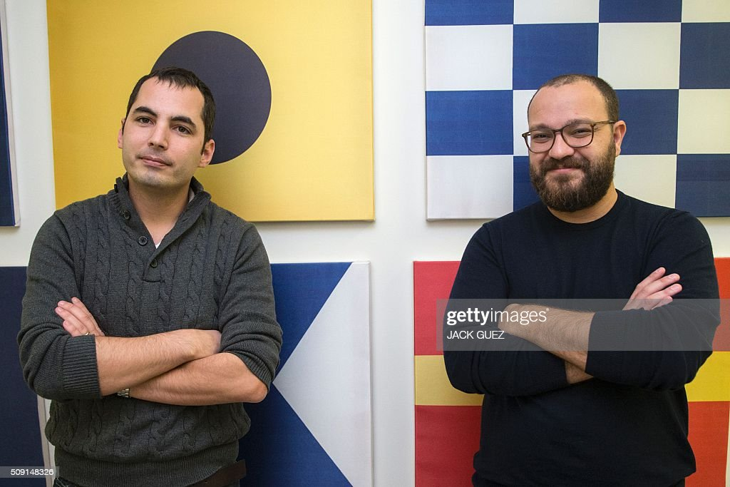 Israeli Ami Daniel (L), CEO and co-founder of the Windward company psoes with co-founder Matan Peled at the company's offices on February 9, 2016 in the Israeli city of Tel Aviv. At a time of deep concern over migrant smuggling, Daniel, a former member of the Israeli navy, says his company Windward has the ability to pick up such suspicious maritime behaviour that would otherwise go unnoticed. GUEZ