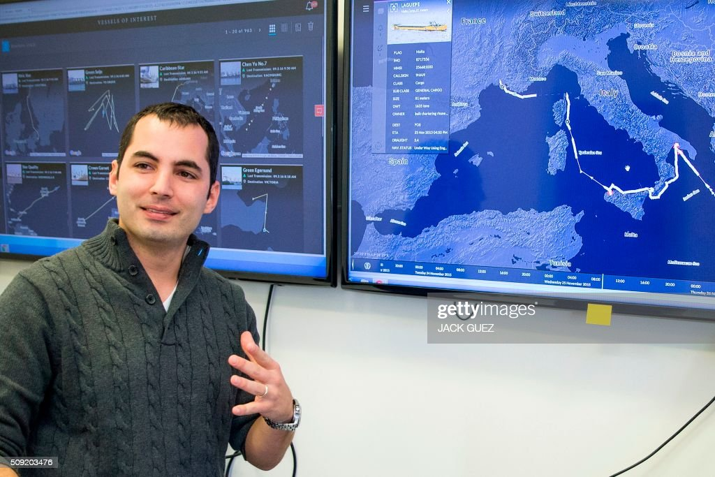 Israeli Ami Daniel, CEO and co-founder of the Windward company speaks in front of a screen as he poses at the company's offices on February 9, 2016 in the Israeli city of Tel Aviv. At a time of deep concern over migrant smuggling, Daniel, a former member of the Israeli navy, says his company Windward has the ability to pick up such suspicious maritime behaviour that would otherwise go unnoticed. / AFP / JACK GUEZ